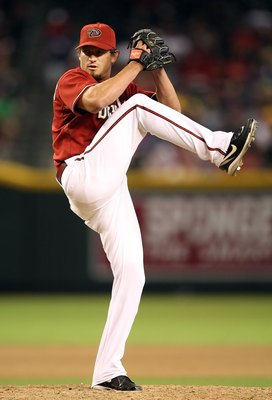 PHOENIX - JULY 28:  Relief pitcher Scott Schoeneweis #60 of the Arizona Diamondbacks pitches against the Philadelphia Phillies during the major league baseball game at Chase Field on July 28, 2009 in Phoenix, Arizona. The Phillies defeated the Diamondback