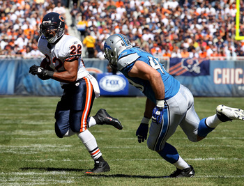 CHICAGO - SEPTEMBER 12: Matt Forte #22 of the Chicago Bears is pursued by Zack Follett #49 of the Detroit Lions during the NFL season opening game at Soldier Field on September 12, 2010 in Chicago, Illinois. The Bears defeated the Lions 19-14. (Photo by J