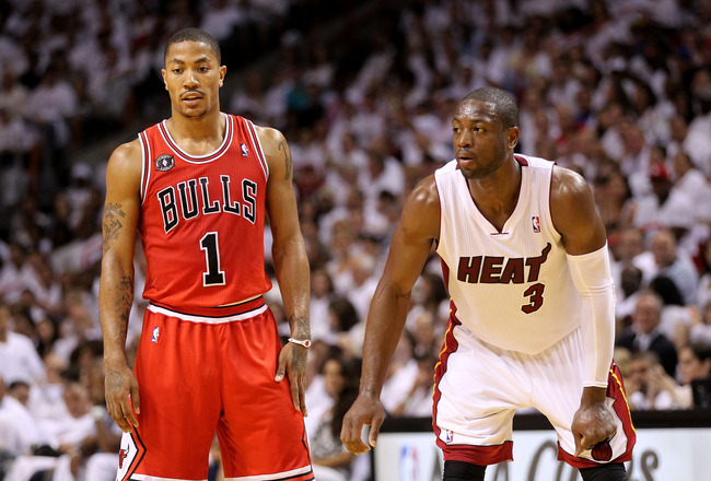 MIAMI, FL - MAY 22:  Derrick Rose #1 of the Chicago Bulls and Dwyane Wade #3 of the Miami Heat look on in Game Three of the Eastern Conference Finals during the 2011 NBA Playoffs on May 22, 2011 at American Airlines Arena in Miami, Florida.  NOTE TO USER: