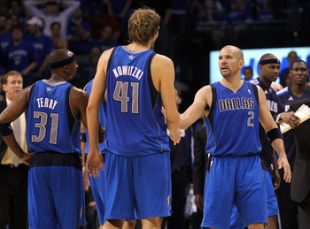 OKLAHOMA CITY, OK - MAY 23:  (R-L) Jason Kidd #2, Dirk Nowitzki #41 and Jason Terry #31 of the Dallas Mavericks celebrates in overtime against the Oklahoma City Thunder in Game Four of the Western Conference Finals during the 2011 NBA Playoffs at Oklahoma