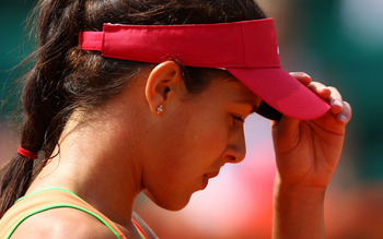PARIS, FRANCE - MAY 24:  A dejected Ana Ivanovic of Serbia reacts as she heads towards defeat during the women's singles round one match between Johanna Larsson of Sweden and Ana Ivanovic of Serbia on day three of the French Open at Roland Garros on May 2