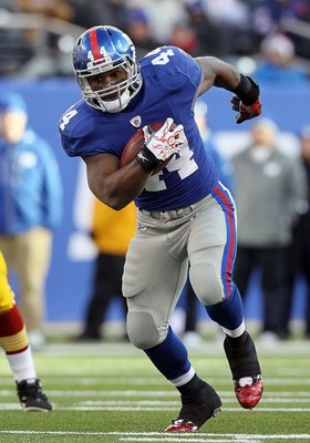 EAST RUTHERFORD, NJ - DECEMBER 05:  Ahmad Bradshaw #44 of the New York Giants runs the ball against the Washington Redskins on December 5, 2010 at the New Meadowlands Stadium in East Rutherford, New Jersey. The Giants defeated the Redskins 31-7.  (Photo b