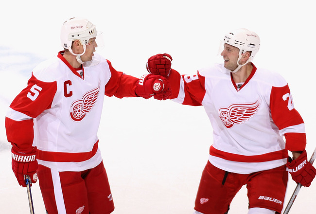 GLENDALE, AZ - APRIL 14:  Nicklas Lidstrom #5 and Brian Rafalski #28 of the Detroit Red Wings celebrate after Nicklas Lidstrom scored a first period power play goal against the Phoenix Coyotes in Game One of the Western Conference Quarterfinals during the