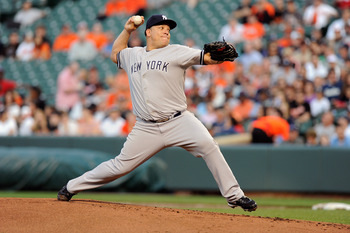BALTIMORE, MD - MAY 18:  Bartolo Colon #40 of the New York Yankees pitches against the Baltimore Orioles at Oriole Park at Camden Yards on May 18, 2011 in Baltimore, Maryland.  (Photo by Greg Fiume/Getty Images)
