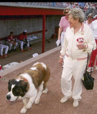 28 Feb 1997:  Cincinnati Reds owner Marge Schott walking past the Cincinnati Reds dugout, with her dog Schottzie, during a spring training game against the Texas Rangers in Plant City, Florida. Mandatory Credit: Allsport  /Allsport
