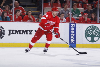 DETROIT - MAY 6: Ruslan Salei #24 of the Detroit Red Wings skates with the puck while playing the San Jose Sharks in Game Four of the Western Conference Semifinals during the 2011 NHL Stanley Cup Playoffs on May 6, 2011 at Joe Louis Arena in Detroit, Mich