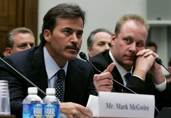 WASHINGTON - MARCH 17:  Baltimore Oriole Rafael Palmeiro testifies as Boston Red Sox pitcher Curt Schilling listens during a House Committe session investigating Major League Baseball's effort to eradicate steroid use on Capitol Hill March 17, 2005 in Was