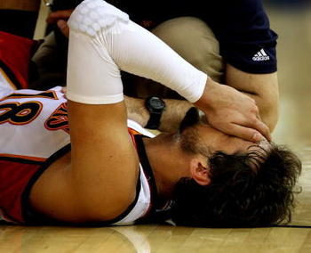 OAKLAND, CA - JANUARY 11:  Marco Belinelli #18 of the Golden State Warriors is in pain after an injury against the Indiana Pacers during an NBA game on January 11, 2009 at Oracle Arena in Oakland, California. NOTE TO USER: User expressly acknowledges and