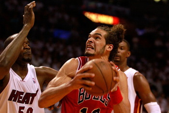 MIAMI, FL - MAY 24:  Joakim Noah #13 of the Chicago Bulls moves the ball inside against Joel Anthony #50 of the Miami Heat in Game Four of the Eastern Conference Finals during the 2011 NBA Playoffs on May 24, 2011 at American Airlines Arena in Miami, Flor