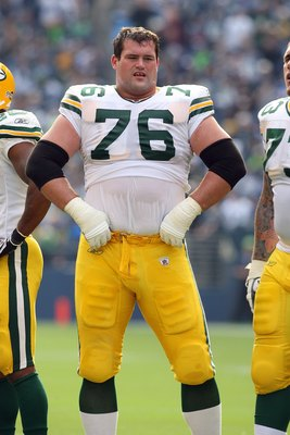 SEATTLE - OCTOBER 12:  Chad Clifton #76 of the Green Bay Packers looks on during a break in the game against the Seattle Seahawks on October 12, 2008 at Qwest Field in Seattle, Washington. The Packers defeated the Seahawks 27-17. (Photo by Otto Greule Jr.