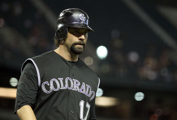 PHOENIX, AZ - MAY 03:  Todd Helton #17 of the Colorado Rockies walks to the dugout during the Major League Baseball against the Arizona Diamondbacks game at Chase Field on May 3, 2011 in Phoenix, Arizona.  The Diamondbacks defeated the Rockies 4-3.  (Phot