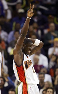 OAKLAND, CA - NOVEMBER 16:  Mickael Pietrus #2 of the Golden State Warriors celebrates after scoring against the Sacramento Kings on November 16, 2006 at Oracle Arena in Oakland, California. NOTE TO USER: User expressly acknowledges and agrees that, by do