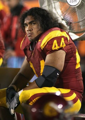 LOS ANGELES, CA - NOVEMBER 29:  Christian Tupou #44 of the USC Trojans sits on the bench during the game against the Notre Dame Fighting Irish at Los Angeles Memorial Coliseum on November 29, 2008 in Los Angeles, California. The Trojans defeated the Fight