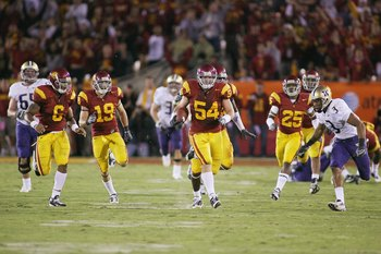 LOS ANGELES - NOVEMBER 1:  Chris Galippo #54 of the USC Trojans returns an interception 50 yards against the Washington Huskies in the fourth quarter on November 1, 2008 at the Los Angeles Memorial Coliseum in Los Angeles, California.  USC won 56-0.  (Pho