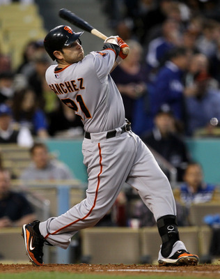 LOS ANGELES - MAY 18:  Freddy Sanchez #21 of the San Francisco Giants hits an RBI single in the third inning against the Los Angeles Dodgers on May 18, 2011 at Dodger Stadium in Los Angeles, California.  (Photo by Stephen Dunn/Getty Images)