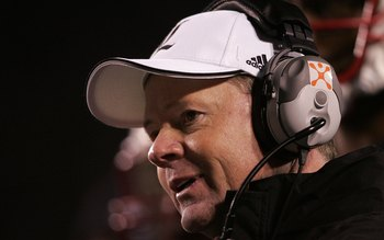 LOUISVILLE, KY - NOVEMBER 02:  Head coach Bobby Petrino of the Louisville Cardinals smiles against the West Virginia Mountaineers November 2, 20006 at Papa John's Cardinal Stadium in Louisville, Kentucky. Louisville won 44-34. (Photo by Andy Lyons/Getty I
