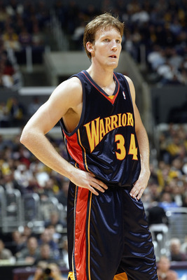 LOS ANGELES - NOVEMBER 2:  Mike Dunleavy #34 of the Golden State Warriors stands on the court during the game against the Los Angeles Lakers on November 2, 2003 at the Staples Center in Los Angeles, California.  The Lakers won 87-72.  NOTE TO USER: User e