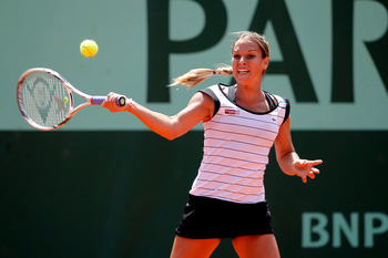 PARIS, FRANCE - MAY 24:  Dominika Cibulkova of Slovakia hits a forehand during the women's singles round one match between Dominika Cibulkova of Slovakia and Vania King of USA on day three of the French Open at Roland Garros on May 24, 2011 in Paris, Fran