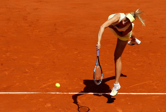 PARIS, FRANCE - MAY 24:  Maria Sharapova of Russia serves during the women's singles round one match between Maria Sharapova of Russia and Mirjana Lucic of Croatia on day three of the French Open at Roland Garros on May 24, 2011 in Paris, France.  (Photo