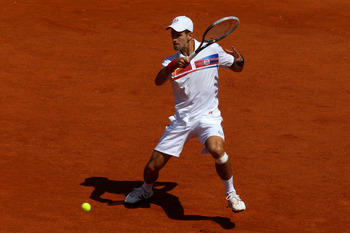 PARIS, FRANCE - MAY 23:  Novak Djokovic of Serbia hits a forehand during the men's singles first round match between Thiemo De Bakker of Netherlands and Novak Djokovic of Serbia on day two of the French Open at Roland Garros on May 23, 2011 in Paris, Fran