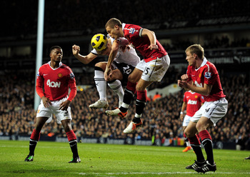 LONDON, ENGLAND - JANUARY 16:  Michael Dawson of Spurs and Nemanja Vidic of Manchester United battle for a header during the Barclays Premier League match between Tottenham Hotspur and Manchester United at White Hart Lane on January 16, 2011 in London, En