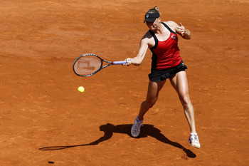 PARIS, FRANCE - MAY 23:  Vera Zvonareva of Russia plays a forehand during the women's singles round one match between Vera Zvonareva of Russia and Lourdes Dominguez Lino of Spain on day two of the French Open at Roland Garros on May 23, 2011 in Paris, Fra