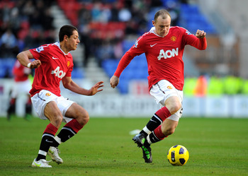 WIGAN, ENGLAND - FEBRUARY 26:  Wayne Rooney (R) and Chicharito of Manchester United in action during the Barclays Premier League match between Wigan Athletic and Manchester United at the DW Stadium on February 26, 2011 in Wigan, England.  (Photo by Mike H