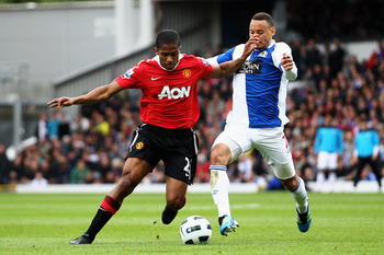 BLACKBURN, ENGLAND - MAY 14:  Jermaine Jones of Blackburn battles for the ball with Antonio Valencia of Manchester United during the Barclays Premier League match between Blackburn Rovers and Manchester United at Ewood park on May 14, 2011 in Blackburn, E