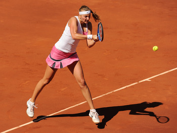 MADRID, SPAIN - MAY 08:  Petra Kvitova of the Czech Republic plays a double handed backhand to Victoria Azarenka of Belarus in her final match during day eight of the Mutua Madrilena Madrid Open Tennis on May 8, 2011 in Madrid, Spain.  (Photo by Jasper Ju