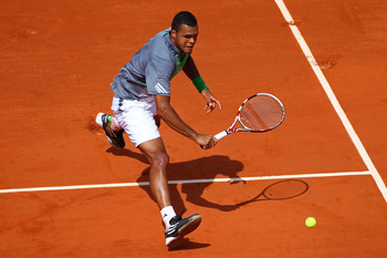 PARIS, FRANCE - MAY 22:  Jo-Wilfried Tsonga of France plays a backhand during the men's singles round one match between Jan Hajek of Czech Republic and Jo-Wilfried Tsonga of France on day one of the French Open at Roland Garros on May 22, 2011 in Paris, F