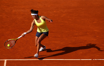 PARIS, FRANCE - MAY 22:  Julia Goerges of Germany hits a forehand during the women's singles round one match between Mathilde Johansson of France and Julia Goerges of Germany on day one of the French Open at Roland Garros on May 22, 2011 in Paris, France.