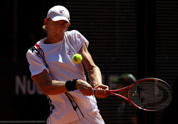 ROME, ITALY - MAY 10:  Kevin Anderson of South Africa plays a backhand return during his first round match against Sam Querrey of USA during day three of the Internazionali BNL d'Italia at the Foro Italico Tennis Centre on May 10, 2011 in Rome, Italy.  (P