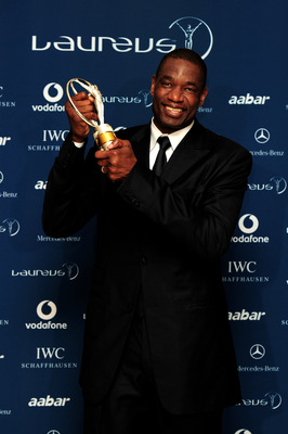 ABU DHABI, UNITED ARAB EMIRATES - MARCH 10:  US basketball legend Dikembe Mutombo poses with his award for 'Sport For Good '  in the Awards room during the Laureus World Sports Awards 2010 at Emirates Palace Hotel on March 10, 2010 in Abu Dhabi, United Ar