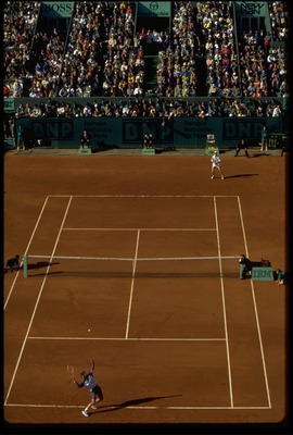 Andre Agassi serves to Jim Courier.