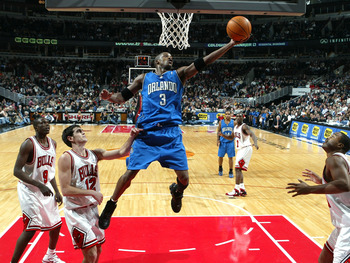 CHICAGO - NOVEMBER 29:  Steve Francis #3 of the Orlando Magic puts up a shot over (from L) Luol Deng #9, Kirk Hinrich #12 and Othella Harrington #24 of the Chicago Bulls on November 29, 2005 at the United Center in Chicago, Illinois.  NOTE TO USER: User e