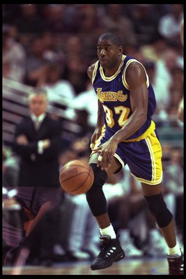 26 Mar 1996:  Guard Magic Johnson of the Los Angeles Lakers moves the ball against the Orlando Magic during a game played at the Orlando Arena in Orlando, Florida.  The Lakers won the game, 113-91. Mandatory Credit: ALLSPORT USA  /Allsport