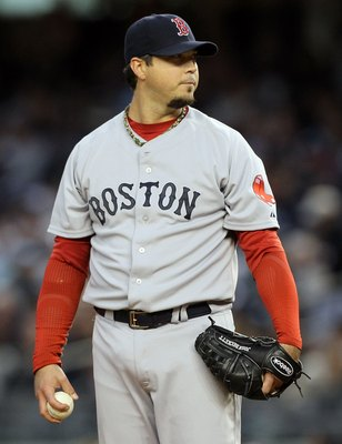 NEW YORK, NY - MAY 14:  Josh Beckett #19 of the Boston Red Sox delivers a pitch against the New York Yankees on May 14, 2011 at Yankee Stadium in the Bronx borough of New York City.  (Photo by Jim McIsaac/Getty Images)