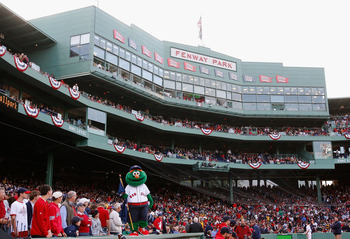 BOSTON - OCTOBER 13:  The Boston Red Sox mascot, Wally the Green Monster stands on the dugout inbetween innings of game three of the American League Championship Series against the Tampa Bay Rays during the 2008 MLB playoffs at Fenway Park on October 13,