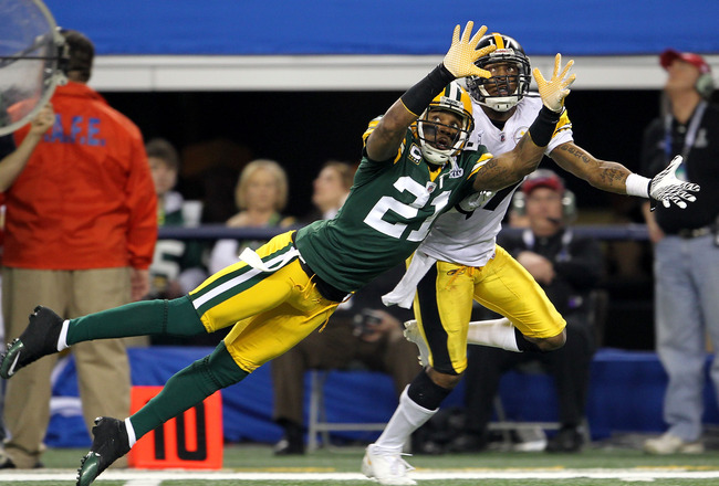 ARLINGTON, TX - FEBRUARY 06:  Charles Woodson #21 of the Green Bay Packers is injured as he attempts to break up a pass intended for Mike Wallace #17 of the Pittsburgh Steelers during Super Bowl XLV at Cowboys Stadium on February 6, 2011 in Arlington, Tex