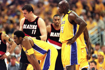 LOS ANGELES - JUNE 4:  Kobe Bryant #8 and Shaquille O'Neal #34 of the Los Angeles Lakers stand on the court during Game 7 of the Western Conference Finals against the Portland Trail Blazers at Staples Center on June 4, 2000 in Los Angeles, California. The