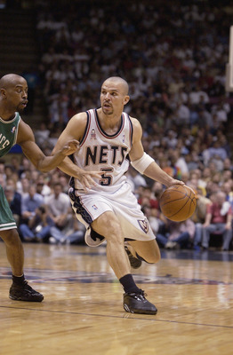 EAST RUTHERFORD, NJ - MAY 29:  Point guard Jason Kidd #5 of the New Jersey Nets drives past point guard Kenny Anderson #7 of the Boston Celtics in Game five of the Eastern Conference Finals during the 2002 NBA Playoffs at Continental Airlines Arena in Eas