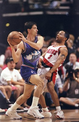 22 May 1999:  John Stockton #12 of the Utah Jazz moves with the ball around Damon Stoudamire #3 of the Portland Trail Blazers during game three of the NBA Western Conference Semifinals at the Rose Garden in Portland, Oregon. The Trail Blazers defeated the
