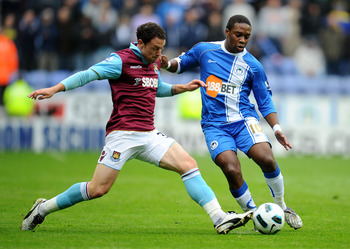 WIGAN, ENGLAND - MAY 15:  Charles N'Zogbia of Wigan Athletic is challenged by Wayne Bridge of West Ham United during the Barclays Premier League match between Wigan Athletic and West Ham United at the DW Stadium on May 15, 2011 in Wigan, England. (Photo b