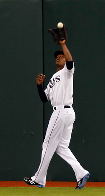 ST. PETERSBURG, FL - MAY 14:  Outfielder B.J. Upton #2 of the Tampa Bay Rays catches a fly ball against the Baltimore Orioles during the game at Tropicana Field on May 14, 2011 in St. Petersburg, Florida.  (Photo by J. Meric/Getty Images)