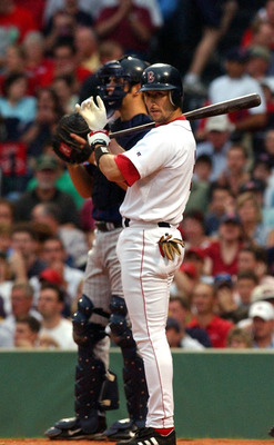 BOSTON - JUNE 22:  Nomar Garciaparra #5 of the Boston Red Sox prepares to bat during the first inning against the Minnesota Twins June 22, 2004 at Fenway Park in Boston, Massachusetts.  (Photo by Darren McCollester/Getty Images)