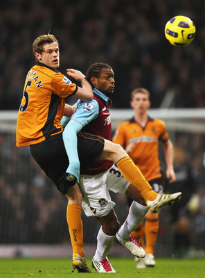 LONDON, ENGLAND - JANUARY 01: Richard Stearman of Wolverhampton Wanderers challenges Frederic Piquionne of West Ham United during the Barclays Premier League match between West Ham United and Wolverhampton Wanderers at the Boleyn Ground on January 1, 2011