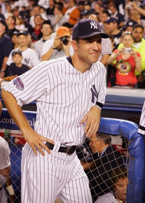 NEW YORK - SEPTEMBER 21: Mike Mussina #35 of the New York Yankees looks on during pregame ceremonies prior to the start of the last regular season game at Yankee Stadium between the Baltimore Orioles and the New York Yankees on September 21, 2008 in the B