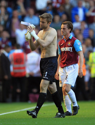 LONDON, ENGLAND - MAY 22: Robert Green and Scott Parker of West Ham United leave the pitch at the end of the game during the Barclays Premier League match between West Ham United and Sunderland at the Boleyn Ground on May 22, 2011 in London, England.  (Ph