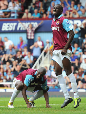 LONDON, ENGLAND - MAY 07:  Carlton Cole and Demba Ba of West Ham United react during the Barclays Premier League match between West Ham United and Blackburn Rovers at the Boleyn Ground on May 7, 2011 in London, England.  (Photo by Mike Hewitt/Getty Images