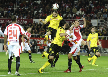 SEVILLE, SPAIN - DECEMBER 15:  Neven Subotic of Borussia Dortmund (C) scores his team's second goal during the UEFA Europa League group J match between Sevilla and Borussia Dortmund at Estadio Ramon Sanchez Pizjuan on December 15, 2010 in Seville, Spain.